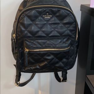 Kate Spade black/gold hardware quitter backpack.